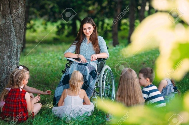Image result for teacher in wheelchair reading to  children""